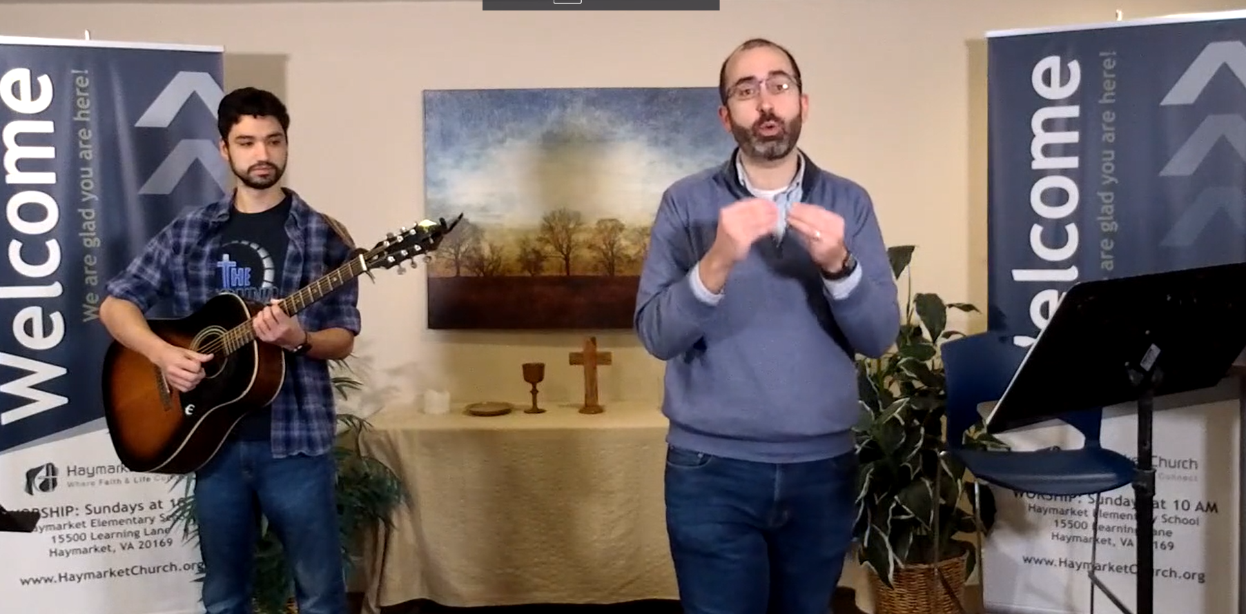 guitarist and pastor leading worship