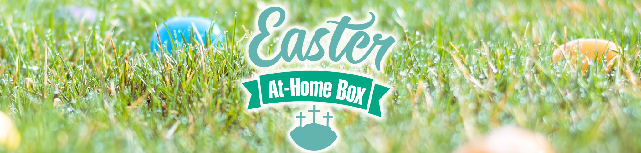 easter eggs in field with Easter at Home Boxes logo