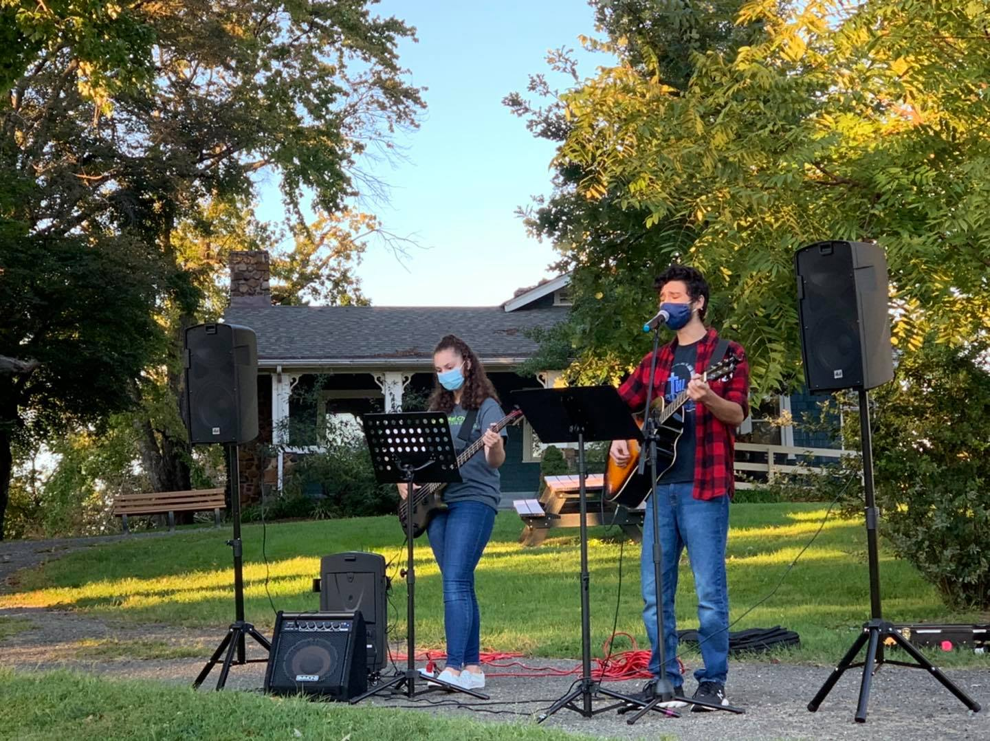 guitarist and bassist at outdoor worship