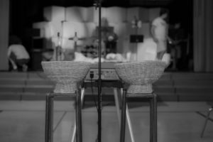offering baskets in foreground, church stage blurred in background