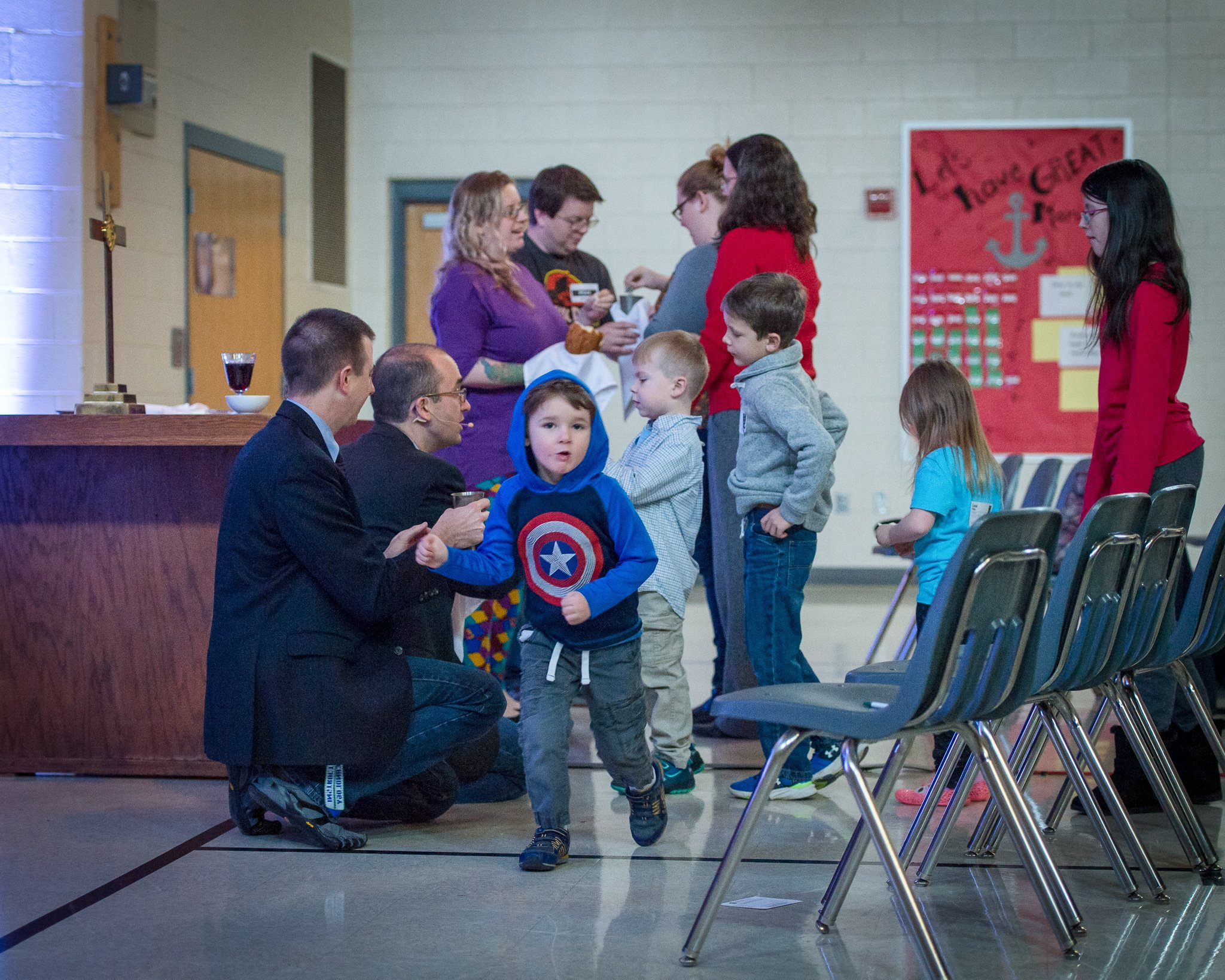 kids at front of worship having tome with the pastor