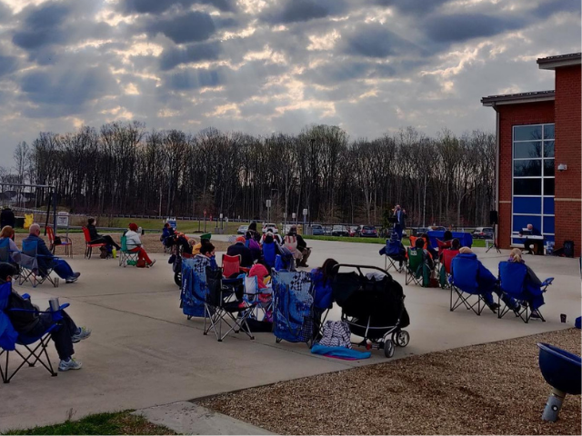 people at outdoor worship on playground